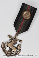 Fantasie medaille, zwart-bruin-groen-rood, ca. 90mm lang